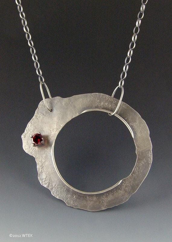 Entropy - A Silver and Garnet Pendant
