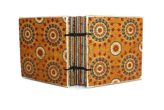 Small Orange and Blue Glittered Coptic Bound Journal.