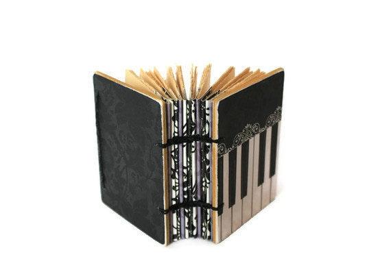 Paula Abdul's Little Coptic Journal in Piano Black