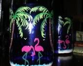 cobalt blue wine bottle glasses palm tree flamingo motif
