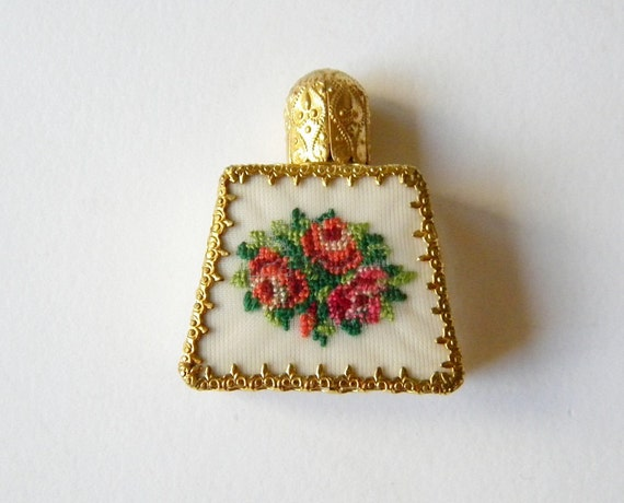 tiny miniature scent or perfume bottle
