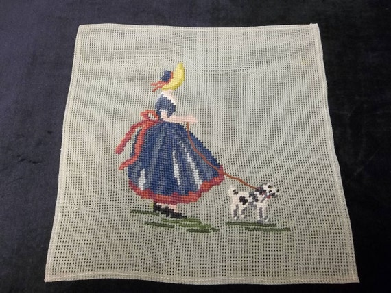 vintage needlepoint with girl and her dog, unfinished background