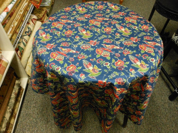 Cotton tablecloth, red-orange gold, green with birds, on navy blue background, 54 inches