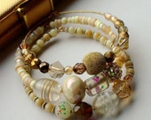 Cream and gold stacking bangles with rhinestone, crystal and lampwork - Bond Girl
