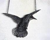 Hummingbird -pendant, drawing on plastic