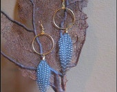 small hoops with speckled feathers