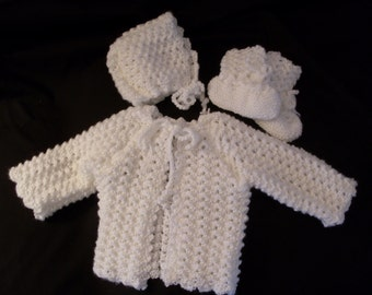 Hand knit girl's white sweater, hat, and booties
