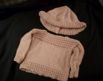 Hand-knit girl's boatneck peach pullover and sun hat