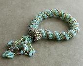 Bracelet. Dutch Tassel, Handwoven. Opal Blue, Green, Copper Brown.