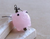 Earrings. Pink Glass Piglets with Black Gunmetal Accents on Black Gunmetal Earwires.