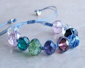 Knotted Pull Bracelet. Light Blue. Faceted Multi-Colored Glass Beads. Silver Plated Pulls.