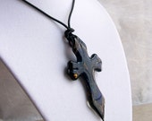 Necklace. Black Glass Cross Pendant with Blue and Copper Foil Accents on Black Leather Cord.