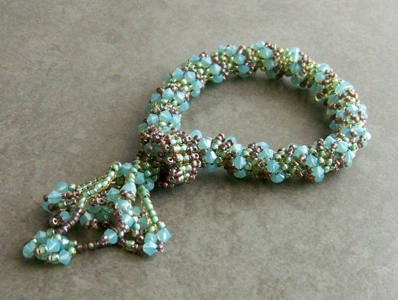 Bracelet. Dutch Tassel, Handwoven. Opal Blue, Green, Copper Brown.