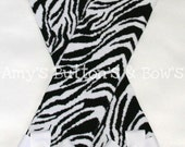 White and black striped zebra leg warmers w/attached white hair bows for added cuteness---Perfect for her upcoming photo shoot, photography