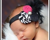 Hot pink black and zebra rolled fabric rosette w/black feathers and pearl accent on a black shimmery elastic headband newborn baby infant