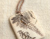 Free Fall - An earthy porcelain necklace with fern imprint and scribbles.