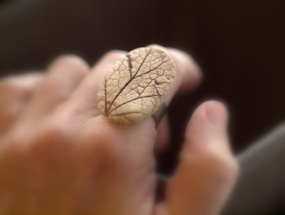 Reveal - An earthy porcelain ring with impression of a Coral Bell leaf.