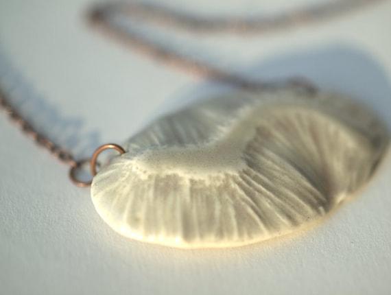 Frill - A porcelain pendant.