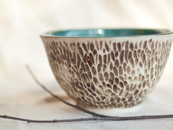 Oasis - A rustic, textured porcelain bowl with turquoise interior.
