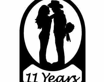 Western Couple Kissing 11 Year Anniversary Sign