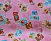 Fabric  Stamps in pink fabric 2 yards