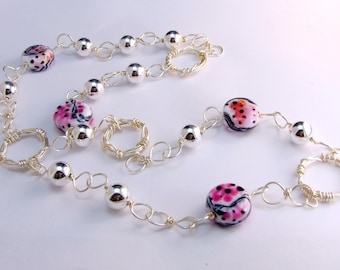 Wild hot pink animal print wirewrapped lampwork long necklace