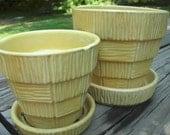 set of yellow mccoy basketweave flower pots