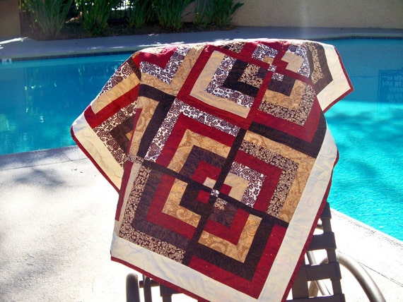 red and brown log cabin wall hanging