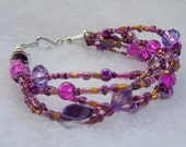 Multi-strand Fuscia and Purple Bracelet