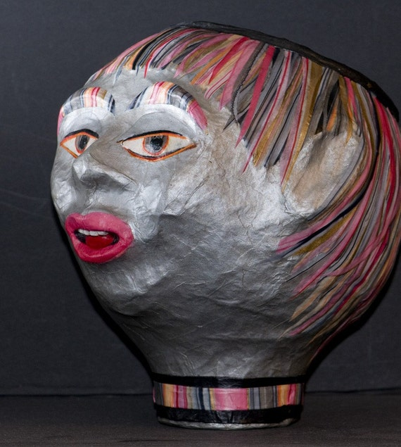 A Silver Paper Mache Head Bowl with Pink Striped Hair Called Rom