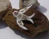 Vintage pin BIRD WITH RHINESTONES RUBY RED EYE flying  silver