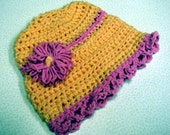 Infant Hat Crocheted in a peach and pink cotton yarn