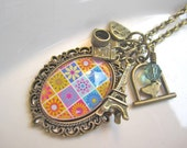 Spring in Paris -- long antique brass charm necklace