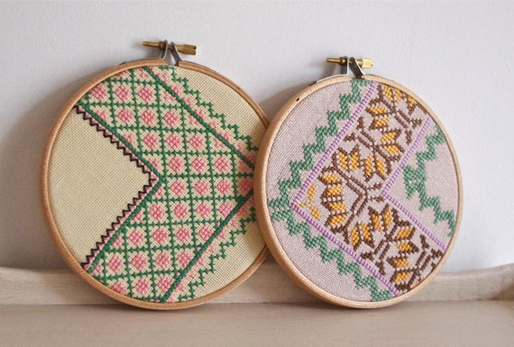 Pair of vintage embroidered zig zag wall art hoops