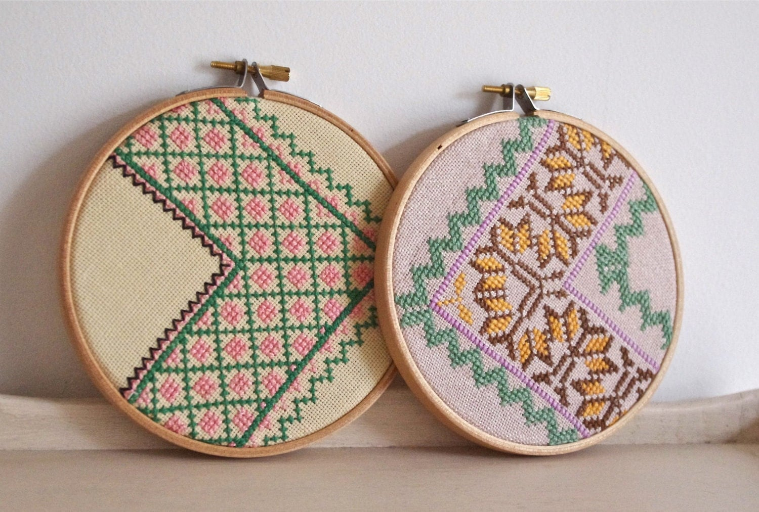 Pair of vintage embroidered zig zag wall art hoops by