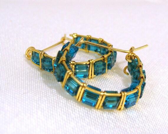 Gold hoop earrings with Indicolite blue Swarovksi cubes