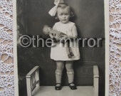 antique vintage postcard,little girl with ragdoll