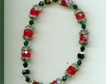 99 cent U.S. shipping ...  Red and Black Bracelet with Silver Accents ... Faceted beads, stretchy bracelet ... discounted international fees