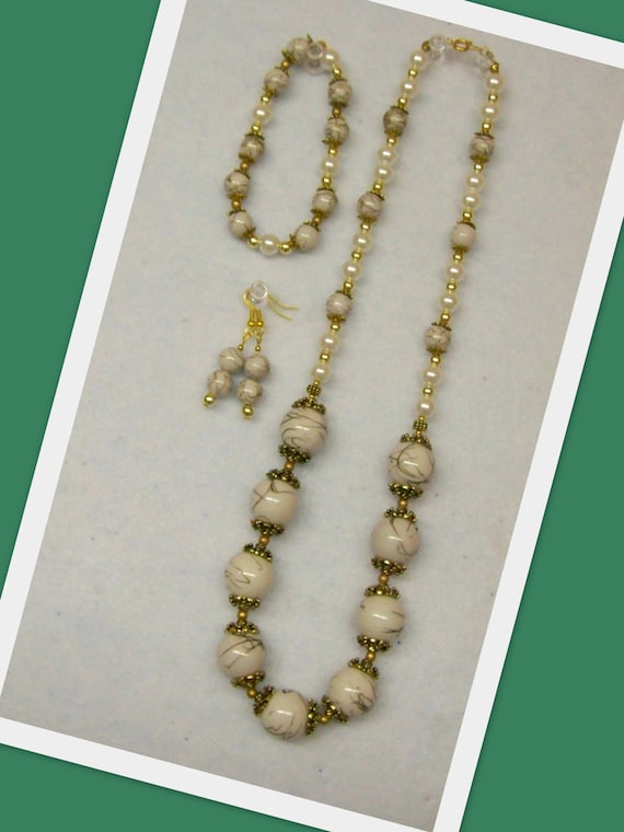 CLEARANCE ITEM ... Jewelry Set - White and Gold ... Necklace, Bracelet and Earrings .... Discount code for 35percent off