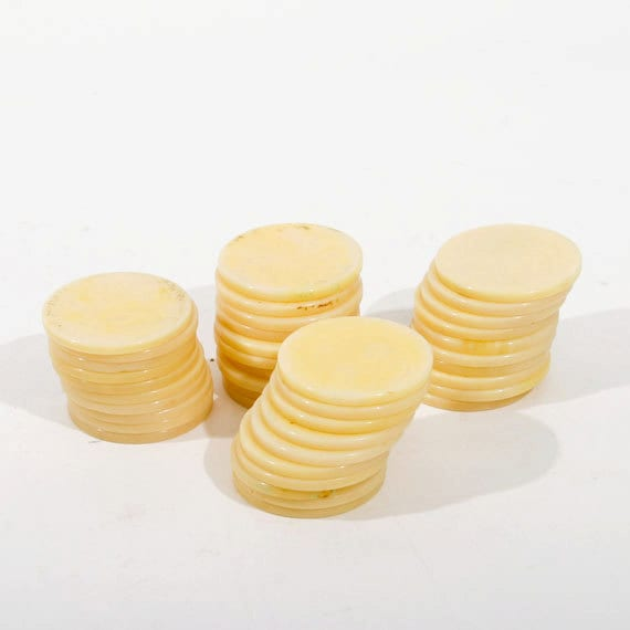 Set of Forty Bakelite, Catalin or Plastic Ivory Colored Marbled Poker Chips