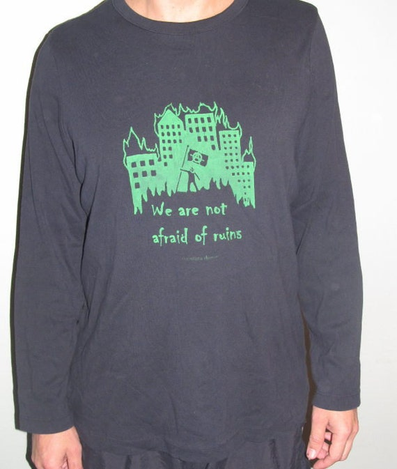 We Are Not Afraid of Ruins, XL, Green Print on Black Long Sleeve T Shirt - Durutti Quote, with Burning Cityscape & Anarchy Flag, Extra Large