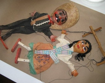 pair of antique puppets