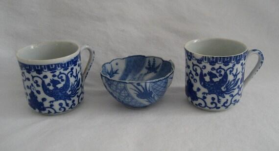 trio of tiny antique blue porcelain cups