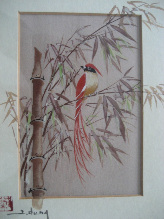 vintage framed watercolor of a bird on a bamboo branch