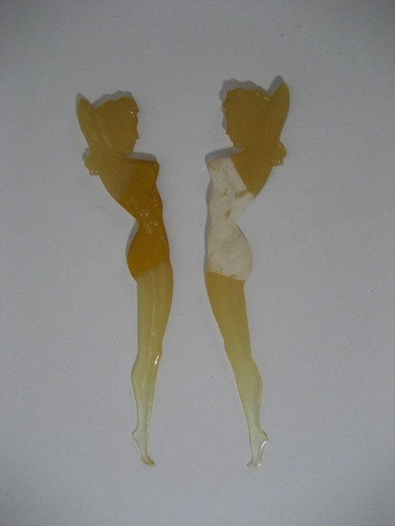 two Bakelite Betty Grable swizzle sticks