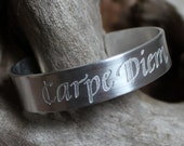 "Latin quote ""Carpe Diem"" in calligraphy, aluminum bangle"