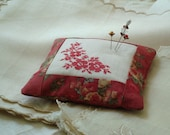 Embroidered red work, linen and cotton pincushion