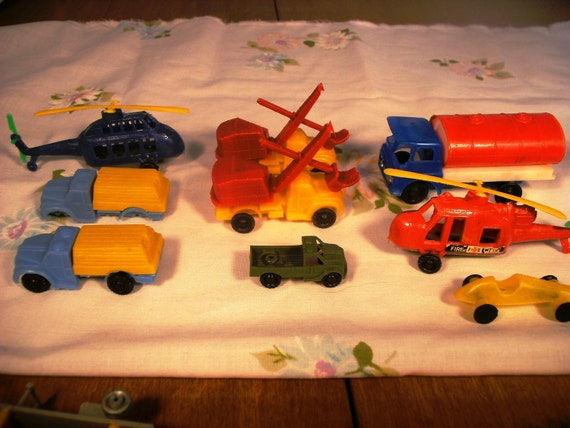 Vintage Plastic toys, transportation, set of 9, helicopters, roadster, Army Jeep, construction trucks, tanker truck, cake toppers