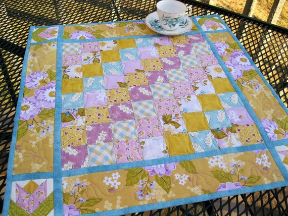 Spring Sunshine quilted table centerpiece in bright spring colors of yellow, orchid and robins egg blue