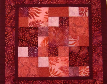 Handcrafted batik red quilted pillow cover